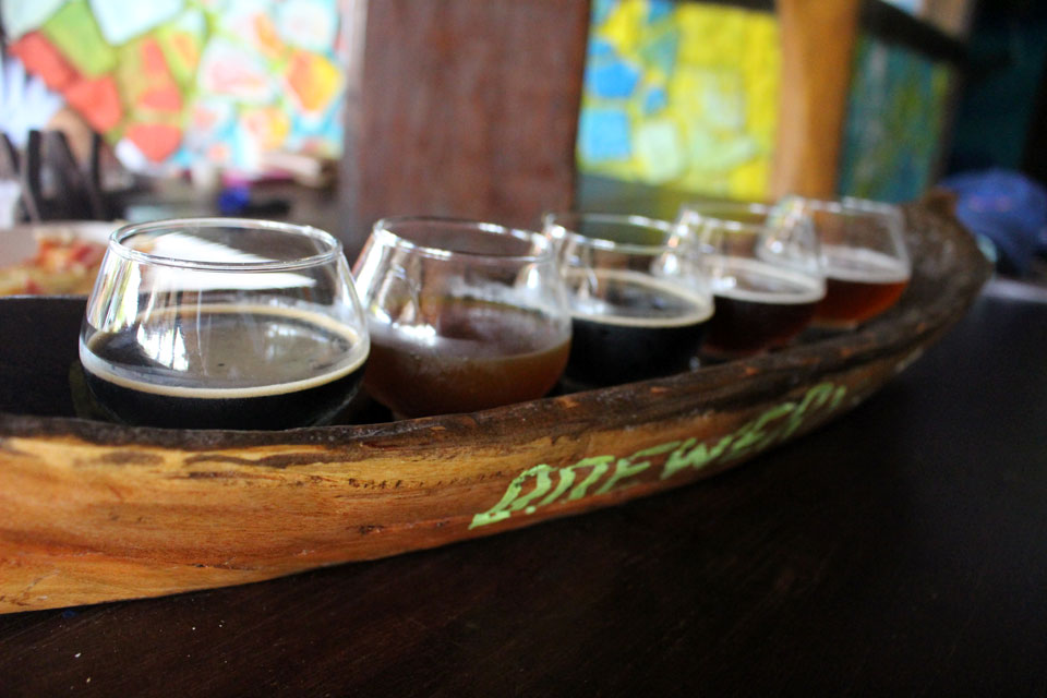 A canoe-style flight of beers at Bribri Springs