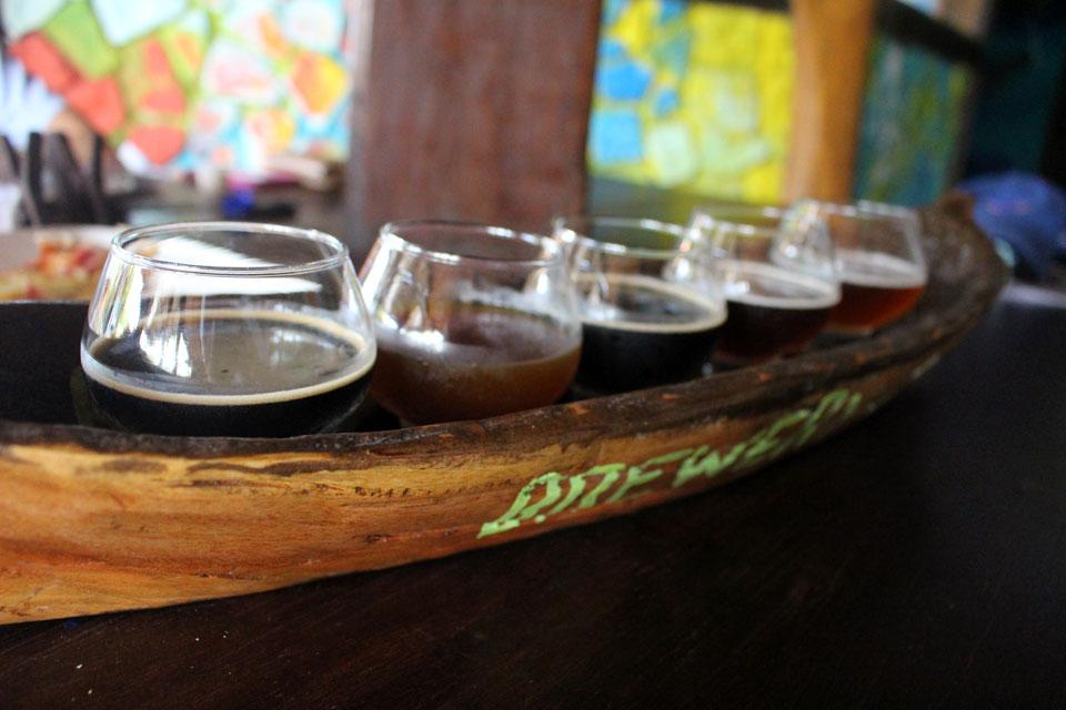 A canoe-style flight of beers at Bribri Springs